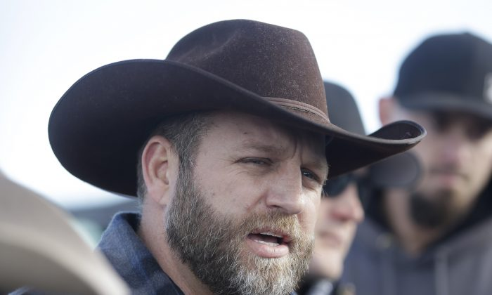 Ammon Bundy, one of the sons of Nevada rancher Cliven Bundy, speaks to reporters during a news conference at Malheur National Wildlife Refuge on Wednesday, Jan. 6, 2016, near Burns, Ore. With the takeover entering its fourth day Wednesday, authorities had not removed the group of roughly 20 people from the Malheur National Wildlife Refuge in eastern Oregon's high desert country. (AP Photo/Rick Bowmer)