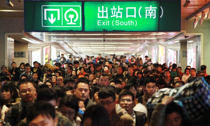 Passengers walk out of Nanjing Railway Station on February 24, 2015 in Nanjing, China. In China's financial markets, traders are also heading for the exits. (ChinaFotoPress/Getty Images)