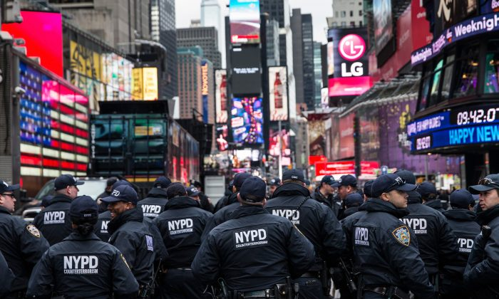 Counterterrorism police officers are briefed in Times Square prior to the Times Square New Year's Eve celebration in New York City on Dec. 31, 2015. The NYPD will have more than 6,000 officers in the Times Square area, including more than 1,100 officers who graduated from the police academy on Tuesday. It will be the largest such deployment of police in New York City ever. (Andrew Burton/Getty Images)