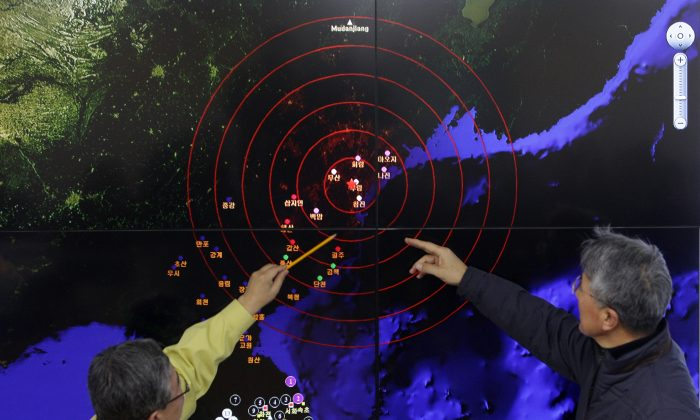 North Korean meteorological officials in Seoul, South Korea, check a screen showing seismic waves on Jan. 6, 2016, from a recent North Korean nuclear weapons test. The test suggests the Chinese regime is having a harder time controlling North Korea. (Chung Sung-jun/Getty Images)