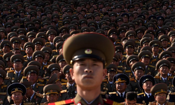 A North Korean soldiers stands before spectators during a mass military parade at Kim Il-sung square in Pyongyang on Oct. 10, 2015. North Korea was marking the 70th anniversary of its ruling Workers' Party. (Ed Jones/AFP/Getty Images)