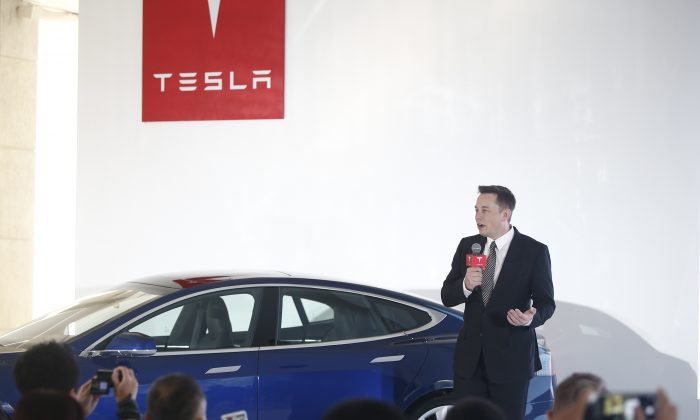 Elon Musk addresses a press conference to declare that the Tesla Motors releases v7.0 System in China on a limited basis for its Model S, which will enable self-driving features on October 23, 2015 in Beijing, China. (ChinaFotoPress/Getty Images)