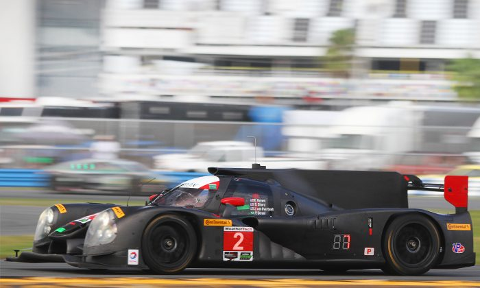 The #2 ESM Ligier-Honda streaks past the grandstands at Daytona International Speedway during the Sunday morning session of the IMSA WeatherTech Roar Before the 24. The car set the fastest time of the weekend in the Sunday Afternoon session. (Chris Jasurek/Epoch Times)