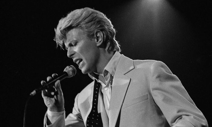 Rock superstar David Bowie, making his first musical performance in America in half a decade, performs on stage at the U.S. Festival on May 31, 1983 at Glen Helen Regional Park in Devore, Calif. (AP Photo/stf/Lennox McLendon)