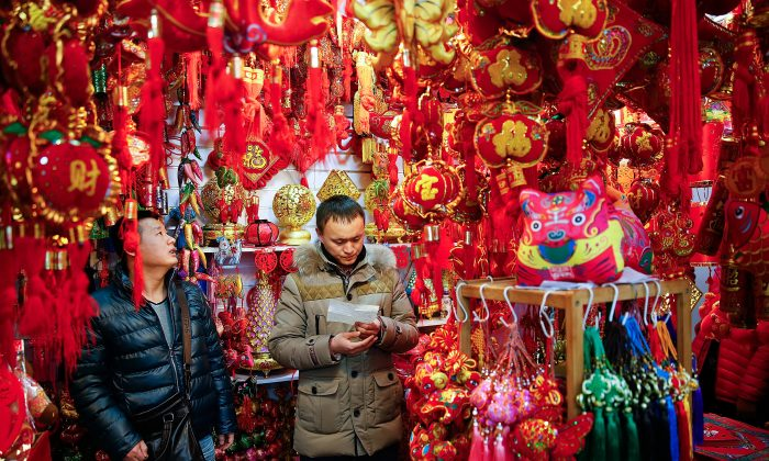 Chinese people buy decorations for the upcoming Chinese Lunar New Year of the sheep in Beijing on Feb. 12. (Lintao Zhang/Getty Images)