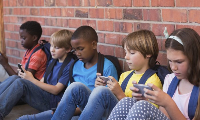 Young people log in more screen time than ever before, and it may have damaging effects on their health. (Wavebreakmedia/iStock)