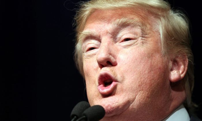 Republican presidential candidate Donald Trump speaks during a rally at the Reno Ballroom and Museum in Reno, Nevada, Sunday, Jan. 10, 2016. (AP Photo/Lance Iversen)