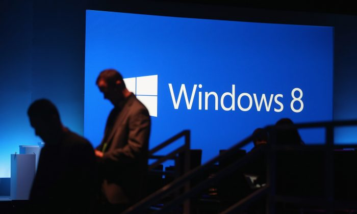 The Microsoft Windows 8 logo is displayed following a press conference unveiling the Microsoft Windows 8 operating system on October 25, 2012 in New York City. (Mario Tama/Getty Images)