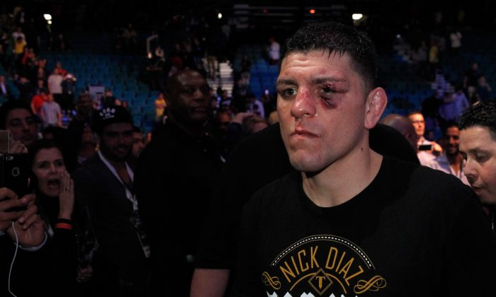 Nick Diaz  leaves the arena after losing to  Anderson Silva in a middleweight bout during UFC 183 at the MGM Grand Garden Arena on January 31, 2015 in Las Vegas, Nevada. Silva won by unanimous decision.  (Photo by Steve Marcus/Getty Images)