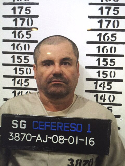 "In this Jan. 8, 2016 image released by Mexico's federal government, Mexico's most wanted drug lord, Joaquin ""El Chapo"" Guzman, stands for his prison mug shot with the inmate number 3870 at the Altiplano maximum security federal prison in Almoloya, Mexico. (Mexico's federal government via AP)"