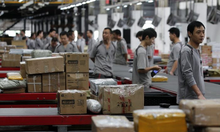 Workers distribute parcels at S.F. Express in Shenzhen, China on on November 11, 2013. (ChinaFotoPress/ChinaFotoPress via Getty Images)