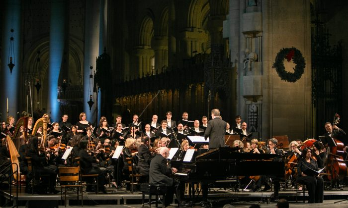 """The performance of composer Robert Sirota's (playing piano) """"Prelude and Spiritual for Mother Emanuel,"""" during the """"New Year's Eve Concert for Peace,"""" at The Cathedral Church of Saint John the Divine in New York, on Dec. 31, 2015. (Benjamin Chasteen/Epoch Times)"""
