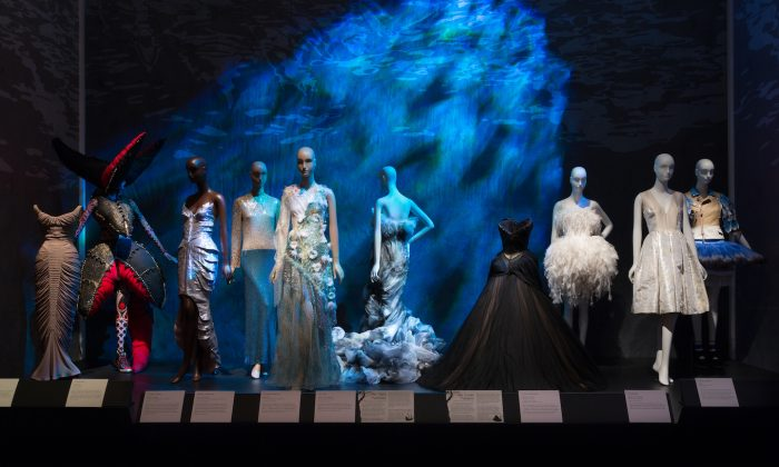 """Clothing illustrating """"The Little Mermaid"""" and """"The Swan Maidens."""" From left to right: clothing by Charles James, Hideki Seo, Thierry Mugler, Norman Norell, Rodarte, Jean Louis Sabaji, Charles James, Jean Louis Sabaji, Giles, and Undercover"""