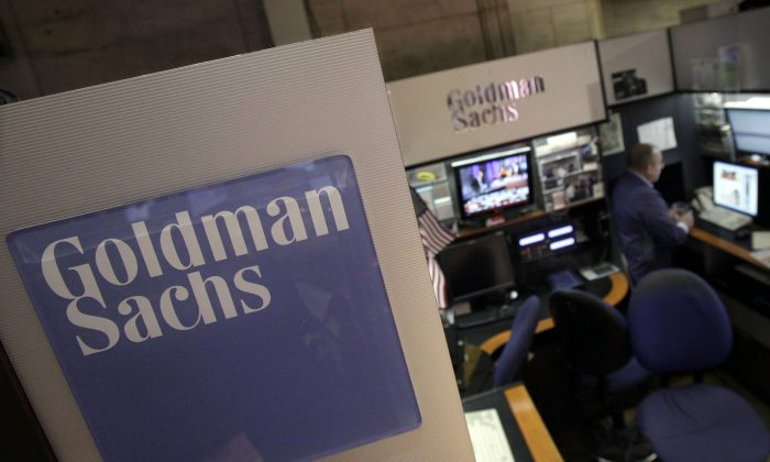 A trader works in the Goldman Sachs booth on the floor of the New York Stock Exchange, in this file photo.  (AP Photo/Richard Drew, File)
