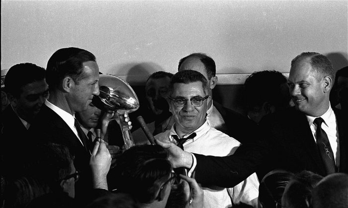 Football commissioner Pete Rozelle, left, presents the trophy to Coach Vince Lombardi of the Green Bay Packers in Los Angeles January 15, 1967, after the Packers trounced the Kansas City Chiefs 35 to 21 in the first Super Bowl football game. (AP Photo)