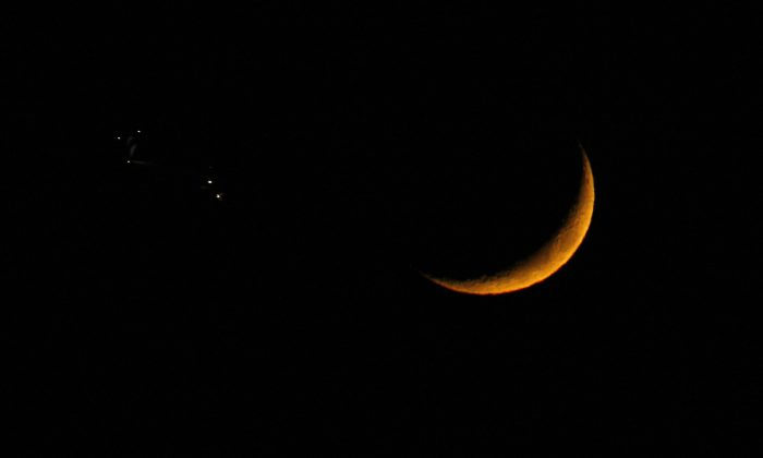A crescent moon is pictured on Dec. 1, 2008, above Nice, France, in a rare alignment with the planets Venus and Jupiter. (VALERY HACHE/AFP/Getty Images)