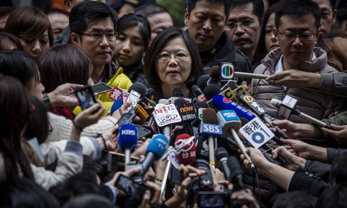 Democratic Progressive Party (DPP) presidential candidate Tsai Ying-wen, talks to journalists after casting her ballot at a polling station in Taipei, Taiwan, on Jan. 16, 2016. (Ulet Ifansasti/Getty Images)