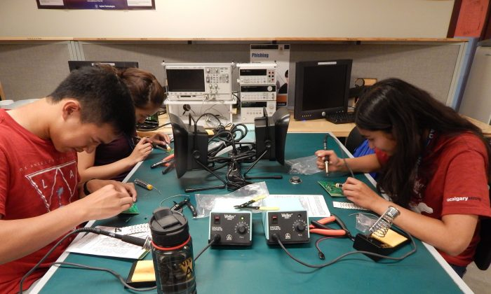 SHAD students at the University of Calgary soldering electronic parts. Thirty participants in the SHAD program have gone on to become Rhodes Scholars. (Courtesy of SHAD)