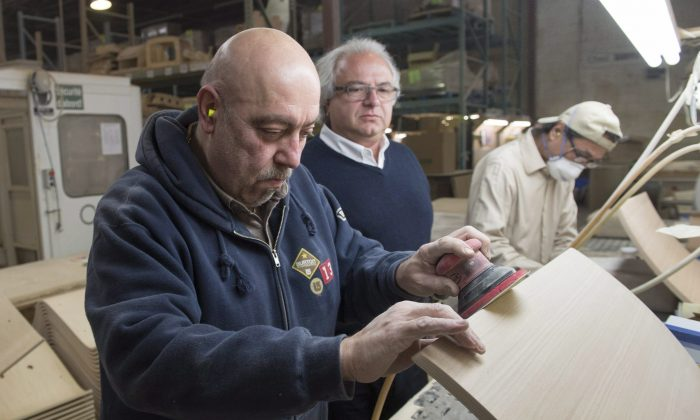 Syrian refugee Garouj Nazarian (L) works at the Seatply Products factory as owner Levon Aseyan looks on, Jan. 18, 2016, in Montreal. The plywood company employs and helps integrate refugees from around the world. (The Canadian Press/Ryan Remiorz)