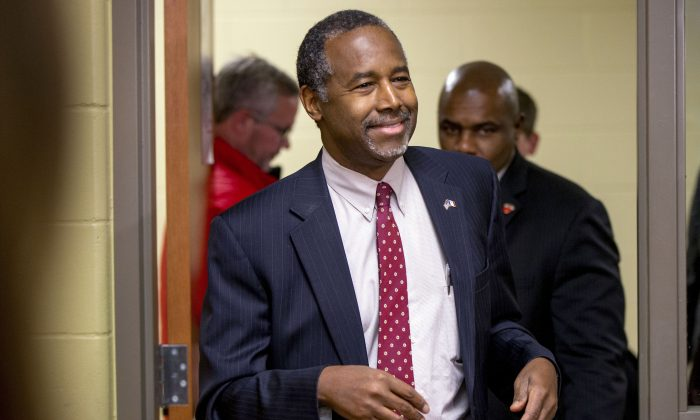 Republican presidential candidate, Dr. Ben Carson arrives to speak to members of the media after speaking at Glenwood Community High School in Glenwood, Iowa, Thursday, Jan. 21, 2016. (AP Photo/Andrew Harnik)