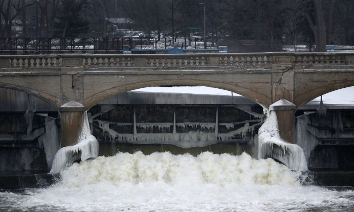 The Flint River near downtown Flint, Mich., on Jan. 21, 2016. City leaders are floating a shockingly high price to replace the city's water infrastructure damaged after the state's disastrous decision in 2014 to use the Flint River as the city's drinking water source without adding a chemical to control corrosion, which caused high levels of chloride from the river to react with iron in the pipes, causing lead to leach into water for a year and a half and contributing to a spike in child lead poisoning before city and state officials fully acknowledged the problem. (AP Photo/Paul Sancya)