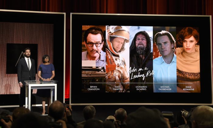 John Krasinski (L) and Academy President Cheryl Boone Isaacs announce the Academy Awards nominations for best performance by an actor in a leading role at the 88th Academy Awards nomination ceremony in Beverly Hills, Calif., on Jan. 14, 2016. The film academy is pledging to double the number of female and minority members by 2020, and will immediately diversify its leadership by adding three new seats to its board of governors. Isaacs announced the changes Friday, Jan. 22, following a weeklong storm of criticism and calls for an Oscar boycott after academy members nominated an all-white slate of actors for the second year in a row. (Chris Pizzello/Invision via AP)