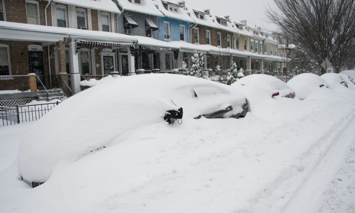 Parked cars are snowed in during a snowstorm in Washington, DC, on January 23, 2016. A blizzard is the perfect time for family in door time. (Nicholas Kamm/AFP/Getty Images)
