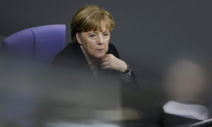 German Chancellor Angela Merkel attends the debate at the German parliament Bundestag on the crime in Cologne during New Year's Eve, in Berlin, Germany, Wednesday, Jan. 13, 2016. (AP Photo/Markus Schreiber)