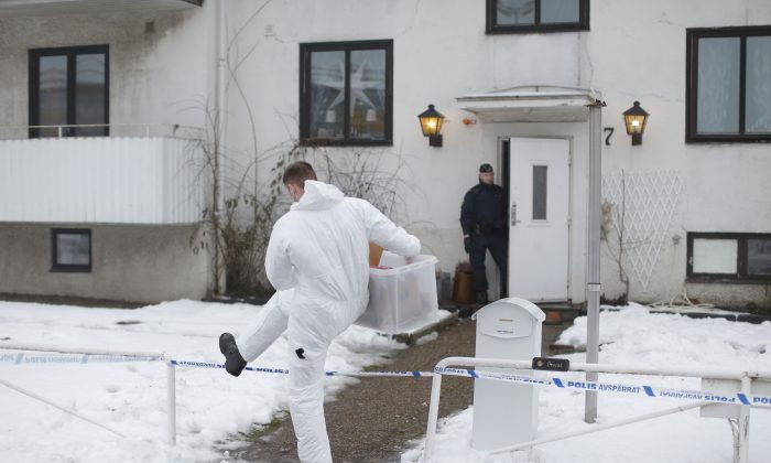 A forensic police officer carries a box of evidence following a search in front of a migrant center in Molndal outside Goteborg, Sweden, Monday, Jan. 25, 2016. A female employee was killed in a knife attack inside the migrant center. (Adam Ihse/ AP Photo) SWEDEN OUT