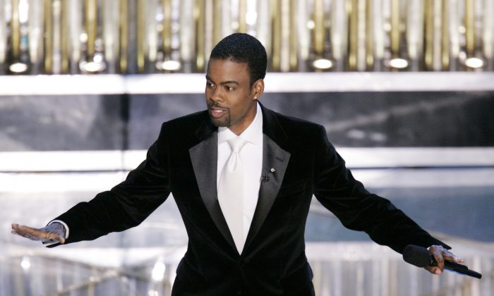 Oscar Host Chris Rock performs his monologue to open the 77th Academy Awards telecast in Los Angeles on Feb. 27, 2005. (AP Photo/Mark J. Terrill, File)
