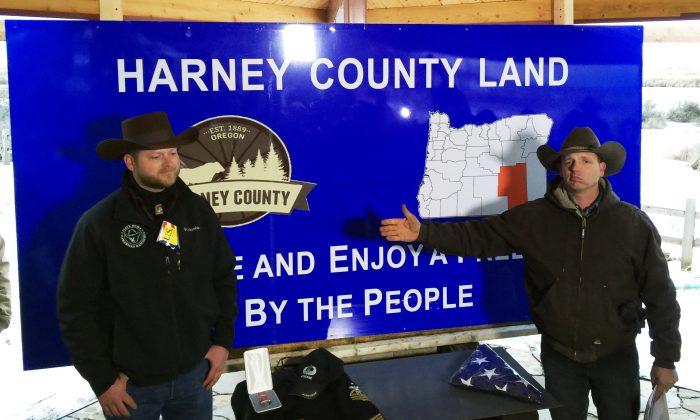 Ryan Bundy, right, gestures toward Adrian Sewell at the Malheur National Wildlife Refuge in near Burns, Ore., Saturday, Jan. 23, 2016.  (AP Photo/Keith Ridler)