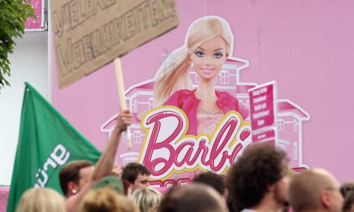 Protesters demonstrating against the social implications of Barbie arrive at the the Barbie Dreamhouse Experience on May 16, 2013 in Berlin, Germany. (Sean Gallup/Getty Images)