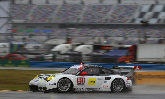 Nick Tandy in the #911 Porsche North America 911 RSR to pole position turned the fastest lap in qualifying for the 2016 WeatherTech SportsCar Championship Rolex 24 at Daytona. (Chris Jasurek/Epoch Times)