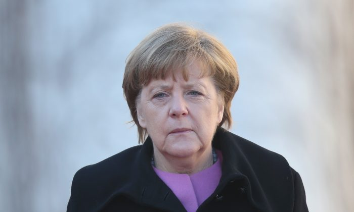 German Chancellor Angela Merkel walks together with Turkish Prime Minister Ahmet Davutoglu following Devatoglu's arrival for German-Turkish government consultations at the Chancellery in Berlin, Germany on Jan. 22, 2016. (Sean Gallup/Getty Images)