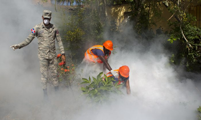 Dominican Air Force personnel fumigate various locations in Santo Domingo against the Aedes aegypti mosquito, vector of the Zika virus, on Jan. 23, 2016. (Erika Santelices/AFP/Getty Images)