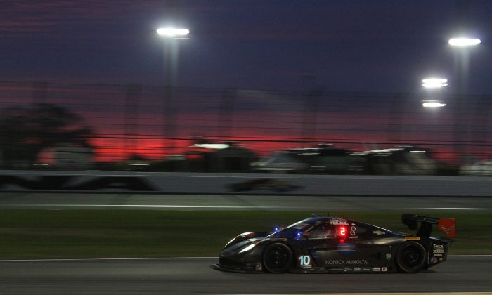 Jordan Taylor in the #10 WTR Dallara-Corvette is part of a three-way fight for the race lead. (Chris Jasurek/Epoch Times)