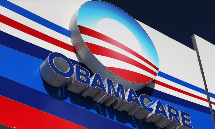 An Obamacare sign is seen on the UniVista Insurance company office in Miami, Fla., on Dec. 15, 2015. (Joe Raedle/Getty Images)
