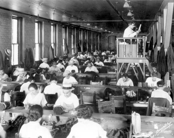 Lector reading at Cuesta Rey cigar company company. (Burgert Brothers. Burgert's Studio - Tampa, Florida)