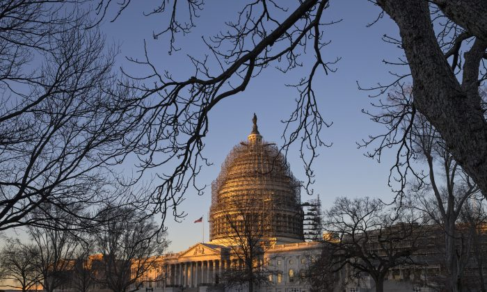 The Capitol reawakens to a bright sunrise and sub-freezing temperatures in Washington, D.C., on Jan. 5, 2016, as lawmakers return to work. (AP Photo/J. Scott Applewhite)
