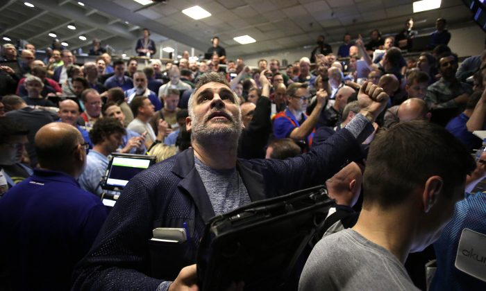 CHICAGO, IL - DECEMBER 16 : Traders in the Standard & Poor's 500 stock index options pit at the Chicago Board Options Exchange (CBOE) react after it was announced that they Federal Reserve would increase interest rates December 16, 2015 in Chicago, Illinois. The Federal Reserves raised the interest rates for the first time since 2006 by 0.25 percentage points. (Photo by Joshua Lott/Getty Images)