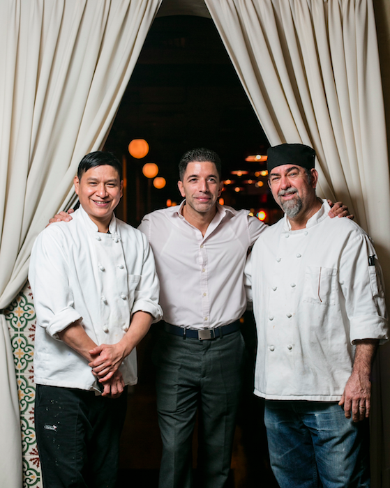 (L–R) Chef de cuisine Manny Lopez, general manager David Diaz, and pizza maker Manny Lopez. Many of the employees have been with the restaurant for more than 20 years. (Samira Bouaou/Epoch Times)
