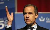Bank of England Keeps Rates Steady, Cuts Growth Forecast