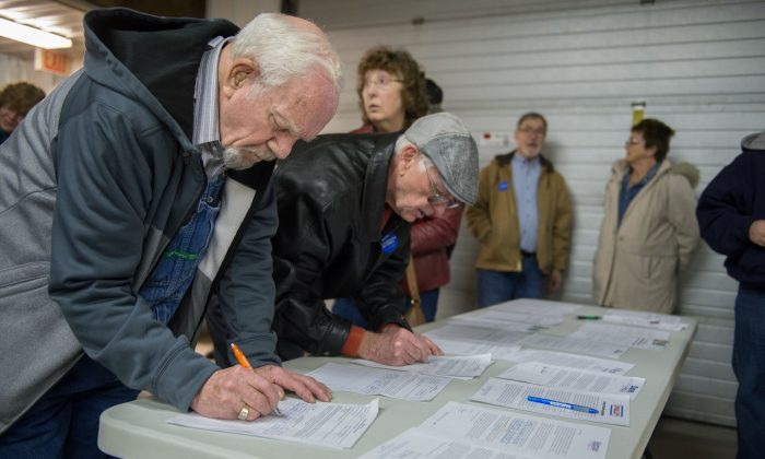 Caucus attendees sign in as they arrive at a Democratic Party Caucus at Jackson Township Fire Station on February 1, (Michael B. thomas/AFP/Getty Images)