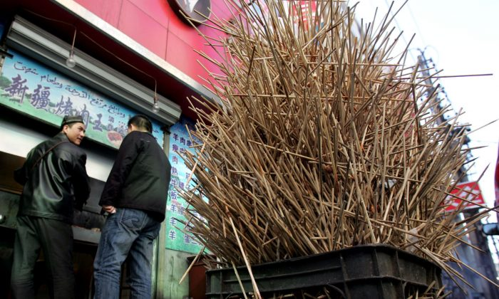 Used wooden chopsticks at a roasted mutton stall on a street on March 23, 2006 in Changchun of Jilin Province, China. (China Photos/Getty Images)