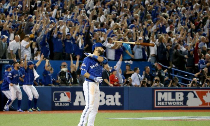 Jose Bautista's emphatic bat flip is probably the most memorable image of the 2015 postseason. (Tom Szczerbowski/Getty Images)