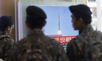 North Korea Praises Rocket; Others View as Covert Missile Test