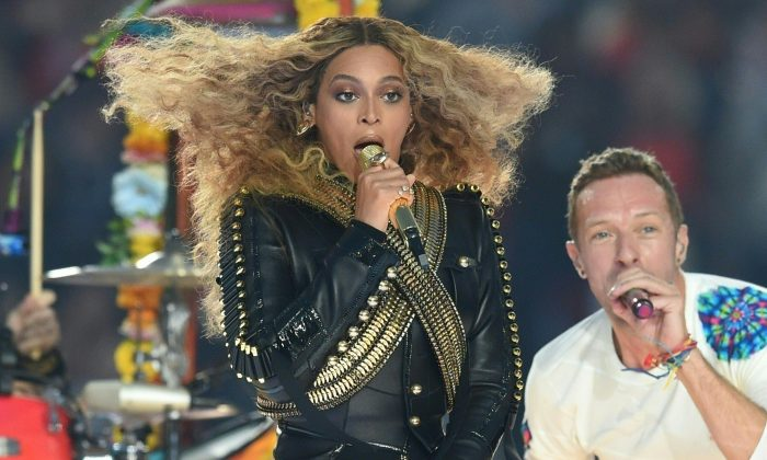 Beyonce and Chris Martin perform during Super Bowl 50 between the Carolina Panthers and the Denver Broncos at Levi's Stadium in Santa Clara, California, on February 7, 2016.     (TIMOTHY A. CLARY/AFP/Getty Images)