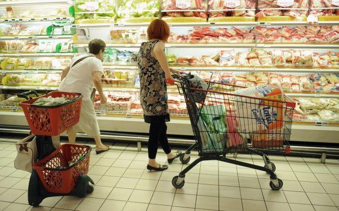 People shop at a supermarket in Gramont, southern France, Aug. 9, 2010. (Remy Gabalda/AFP/Getty Images)