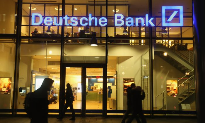 People walk past a branch of Deutsche Bank on February 9, 2016 in Berlin, Germany. Deutsche Bank is under pressure as the three large hedge funds stopped trading derivative contracts with the bank. (Sean Gallup/Getty Images)