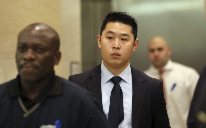 Police Officer Peter Liang exits the courtroom after his closing arguments in his trial on charges in the shooting death of Akai Gurley at the Brooklyn Supreme court on Feb. 9. (AP Photo/Mary Altaffer)